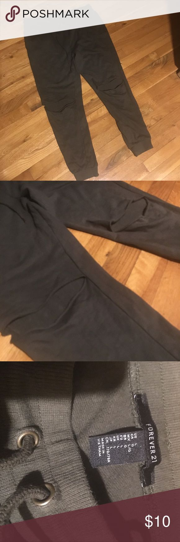 F21 Army Green Sweatpants knees have cutouts, elastic waistband and drawstring, side pockets, left butt cheek has a stain (in photo) elastic by ankle Forever 21 Pants