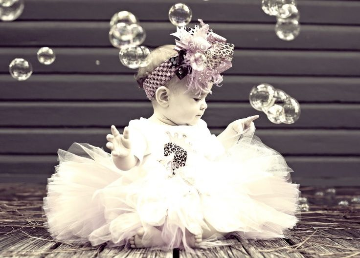 Love the bubble idea. Did this for my little girls first bday shoot  the pics came out awesome!