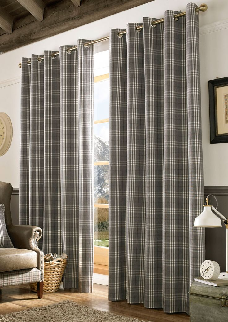 Archie Denim Eyelet - Polyester curtains with a classic check pattern.