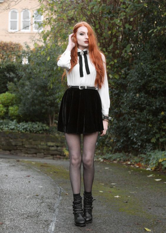 6c0d900fd5 a white vintage style shirt with a black bow and a brooch