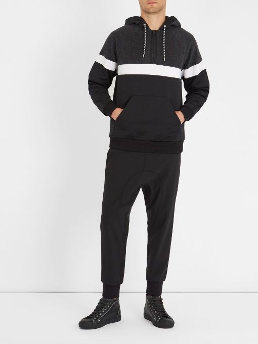 Bold in its simplicity, Givenchy's colour-block hooded sweatshirt contrasts a charcoal-grey fleece top panel with a white neoprene stripe and black cotton-jersey base.