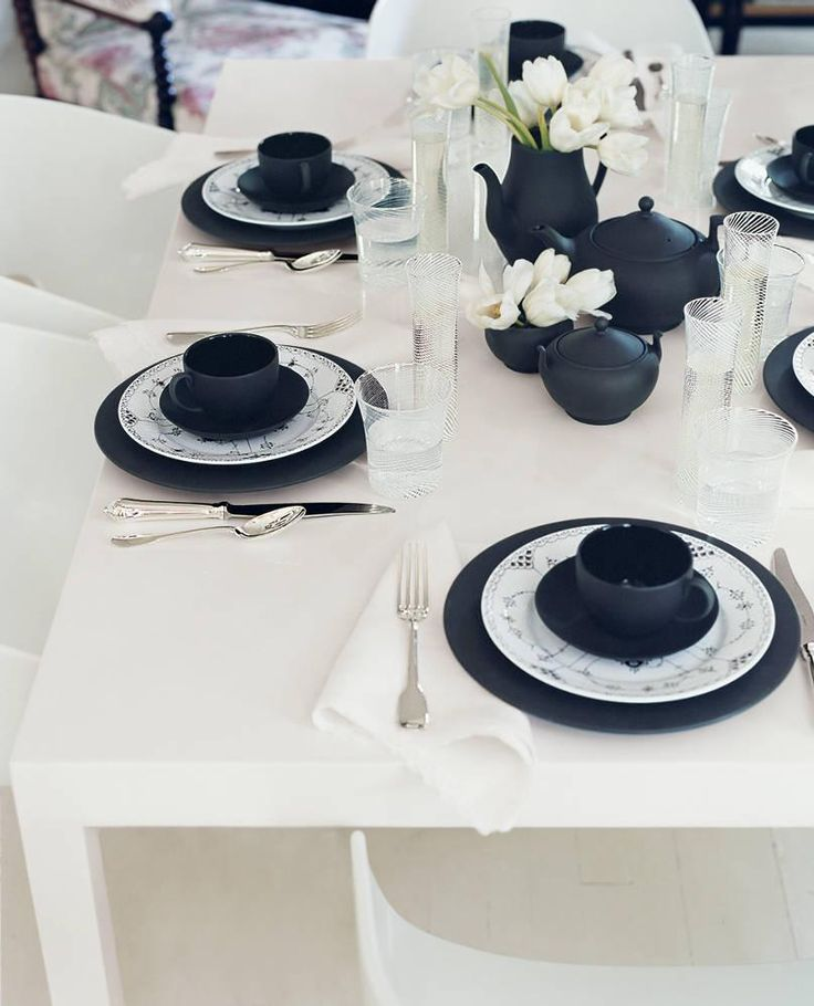 You really can't go wrong. A few choice noir accents and playful graphic flourishes can elevate everyday plates to a dramatic tablescape of light and shadow | domino.com