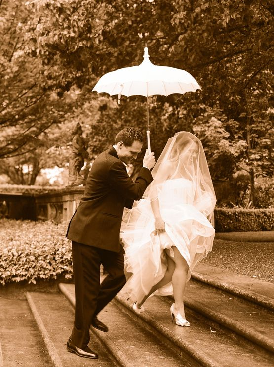 Smile. A rainy wedding day is still yours. And it's fabulous. {Photo by Elizabeth Messina}
