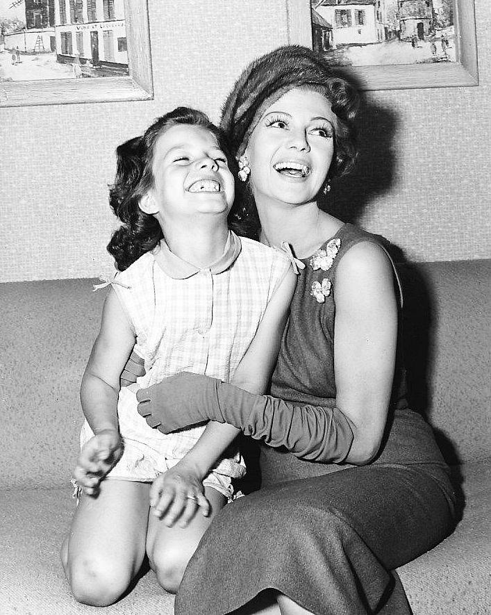"""Rita Hayworth and her daughter Yasmin Aga Khan on the set of Pal Joey, 1957 """