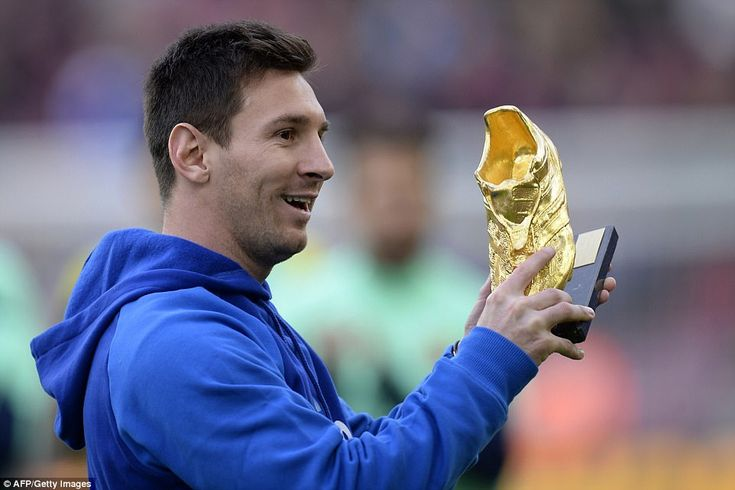 Messi has won theEuropean Golden Shoe on four occasions - pictured showing his accolade to Nou Camp crowd in 2013