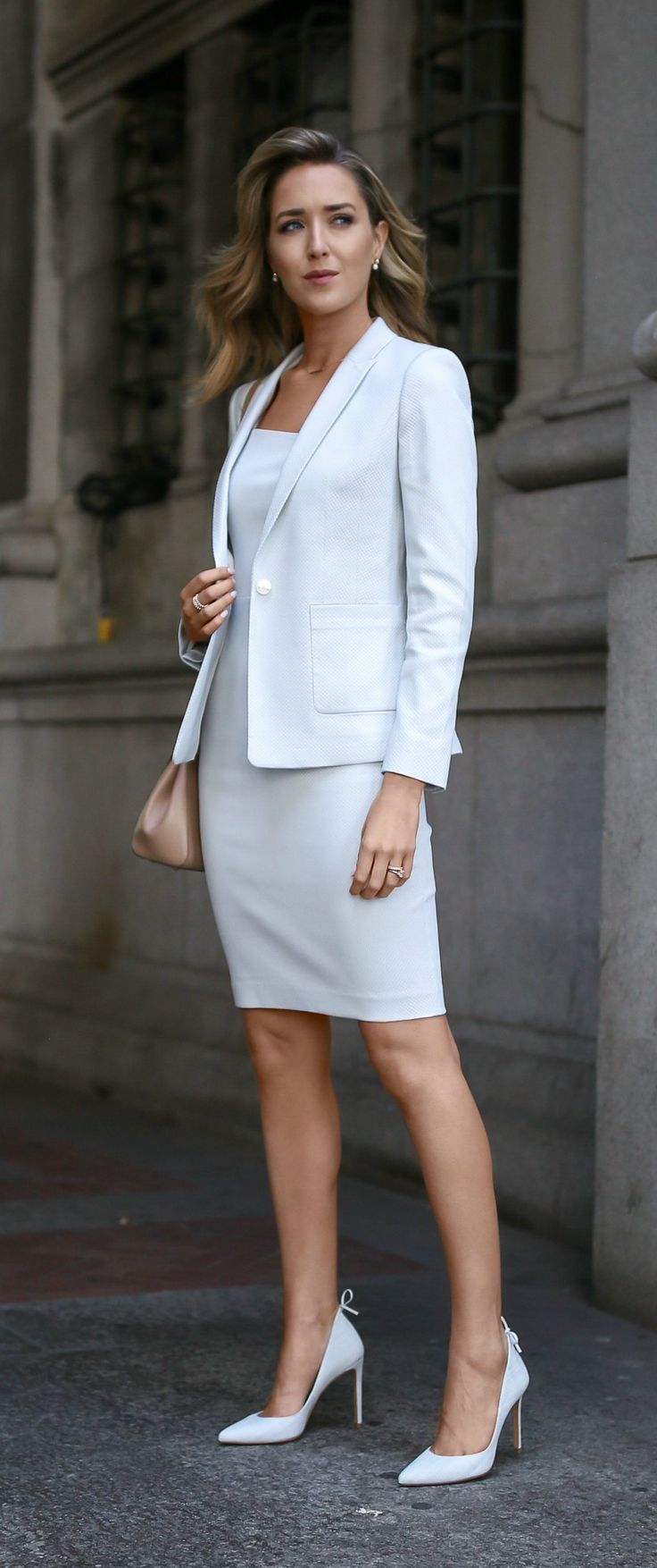 what to wear to a summer business formal job interview // pale robin's egg blue suit // sleeveless sheath dress with asymmetrical hemline // matching suit jacket // coordinating pastel blue classic pointed toe pumps with bow back