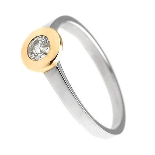 Pierścionek z białego i żółtego złota zbrylantem o masie 0,20 ct. Próba 0,585
