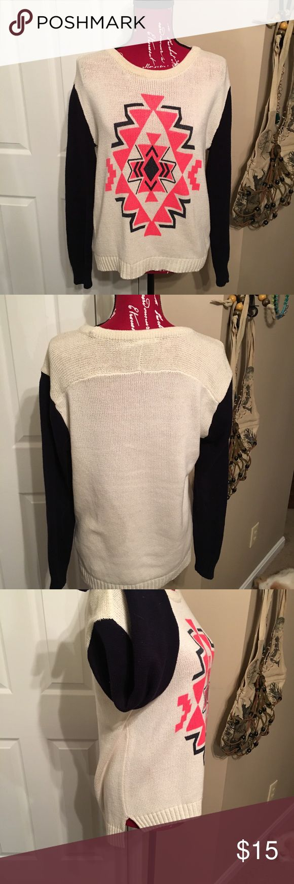 EUC tribal print sweater EUC Tribal print sweater from Forever 21. Cream colored body with gold metallic threading in shoulder and neckline and navy blue sleeves. Pretty bright coral pink tribal design. Hemline is longer in the back. Size M Forever 21 Sweaters Crew & Scoop Necks