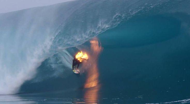 Surfer Jamie OBrien Lights Himself On Fire Before Riding Massive - Guys sets himself on fire before surfing a huge wave