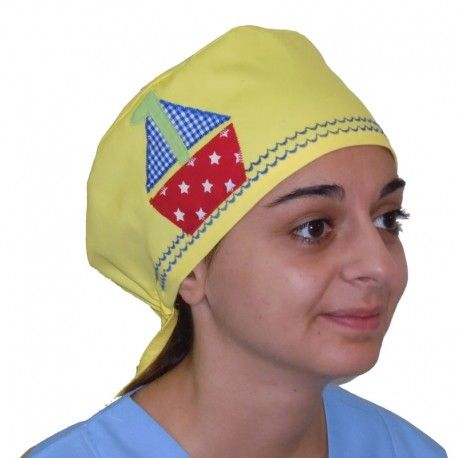 Colorful scrub hat with a cute little boat. For all medical purposes, this vivid, handmade scrub will make your day!