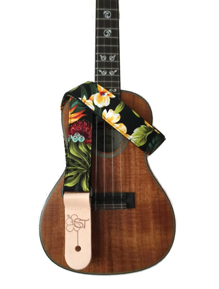 "Description Hand made ukulele straps. Made in the USA. Available in 1"", 1.5"", & 2"" wide with different patterns Care - Do not machine wash - Do not wet leather. This causes discoloration. - Use a wet"