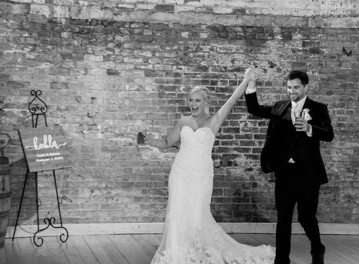 The exposed brick wall in Rhinegeist's Clubhouse is the perfect backdrop for every moment of your reception! Photo by: Frame 805