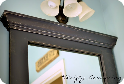 Thrifty Decorating: Frame your bathroom mirror. . .