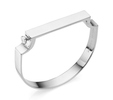 Combining strong clean lines with flowing curves, the handcrafted Signature Petite bangle is both modern and feminine. The simple silhouette fits comfortably around your wrist, with a hinged bar that easily opens and closes with a snap fastener. The petite size bangle measures 50.3mm in height and 57.6mm in width, and is suitable for a wrist size up to 16.5cm in circumference. The bar measures 42.4mm in length, 8mm in width & 2.5mm in depth. Wear effortlessly alone or stack with the…