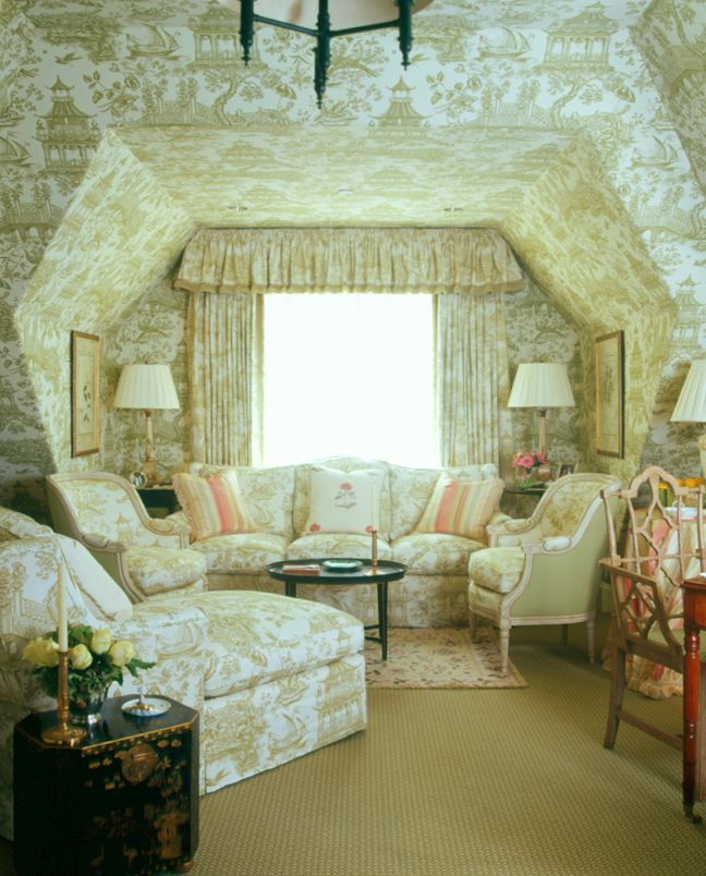 The use of toile all over the room (which is a traditional way to use toile), combined with the slanted ceiling make a delightful sitting area. - Cathy Kincaid Interiors