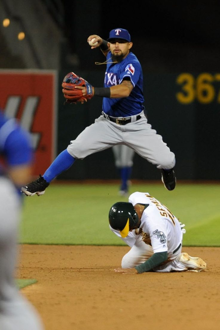 Rougned Odor #12 of the Texas Rangers attempts to turn a double play as Marcus Semien #10 of the Oakland Athletics slides in to second base at O.co Coliseum on June 13, 2016 in Oakland, California. (Photo by Robert Reiners/Getty Images)