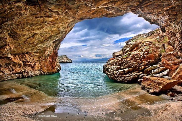 Sea cave next to Limnionas beach, close to Mesochoria village, Evia island, Greece.