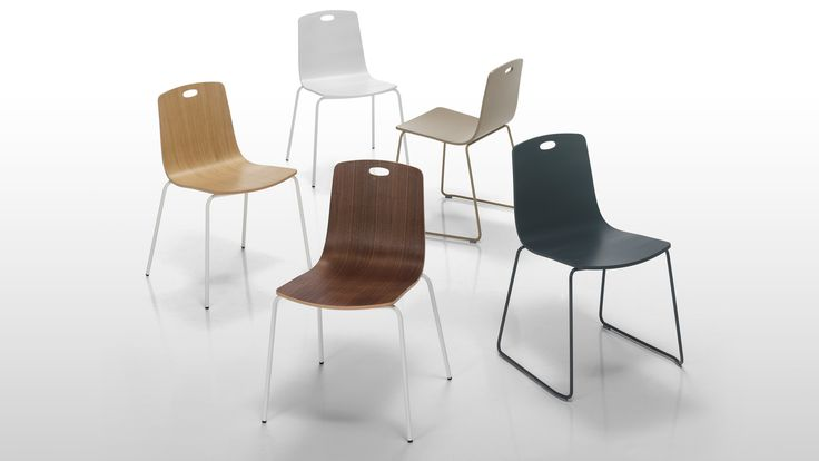 Ann form Sandler Seating. Stacking chairs with optional cut-out detailing on the back.