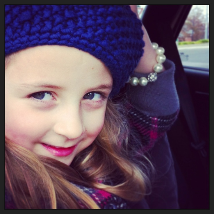 Claude with a knitted Beret, pearl bracelet, pink & grey coat. Not forgetting raspberry lip gloss to go with her Rosie cheeks!