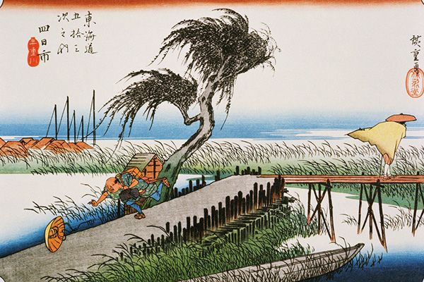 Two travellers are accosted by a gale as they try to cross the Mitaki River, near Yokkaichi in Mie Prefecture. Hiroshige uses the straining boughs of the willow tree in the centre of the print, the abandoned boat in the foreground, and the masts beside the fishing village in the distance to dramatic effect in reproducing the atmosphere of the howling wind.