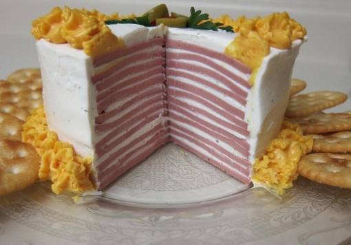 bologna cake with cream cheese and cheez whiz frosting...and ritz crackers.  for the soiree at the trailer park next weekend