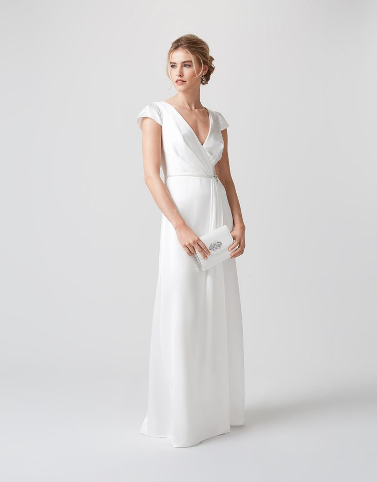 Sleek, sophisticated, and utterly chic, our Veronika ivory wedding dress will ensure your special day is an oh-so-stylish one. Crafted from satin back crepe ...