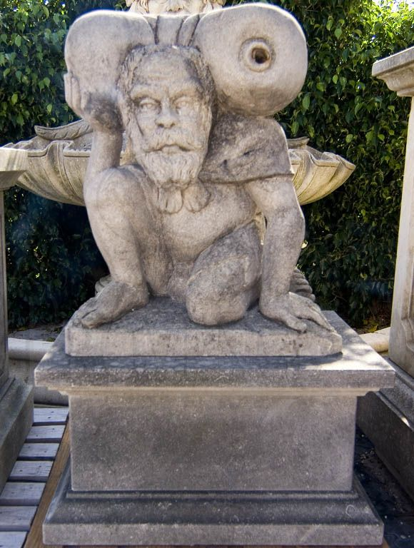 Late 19th century humorous Italian gnome statue in hand carved limestone. This kind of statue was believed to bring prosperity and fortune to their owner.  Similar to a statue in the Park of Pamphili, Rome.   This small limestone statue could also be used as fountain head, circa 1890.