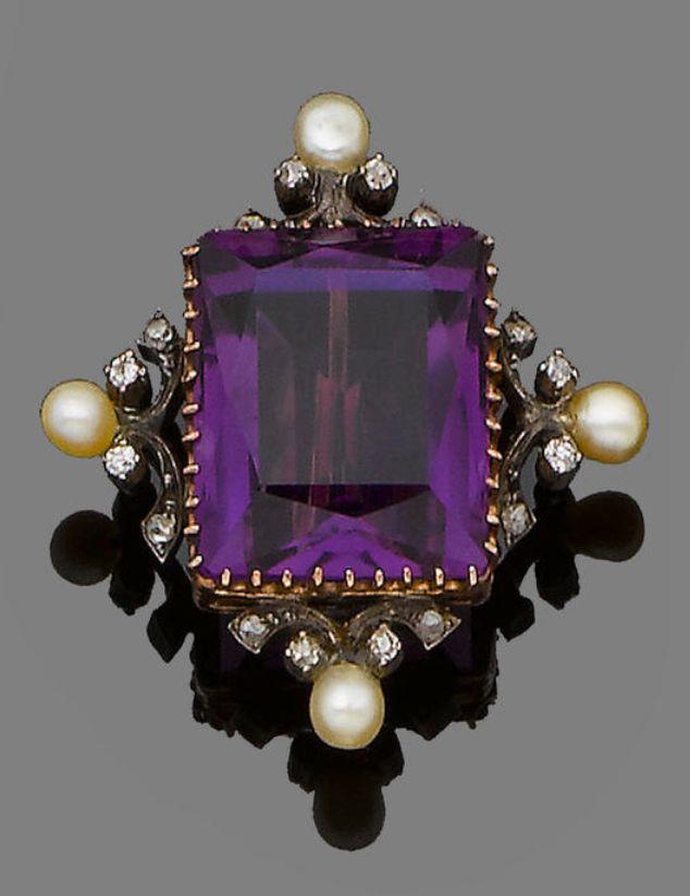 An amethyst and diamond brooch  The scissor-cut amethyst framed by old brilliant-cut diamond and pearl scrolls