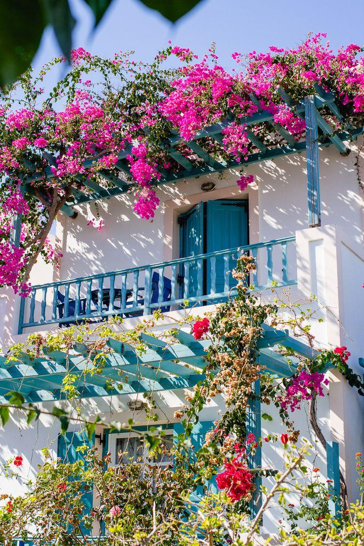 Villa in Perissa Santorini with a blue balcony with pink bougainvillea trailing