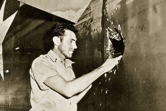 Louie Zamperini - war hero, survivor.  Here he inspects his B-24 after a mission.  The book about this guy is just amazing - Unbroken.