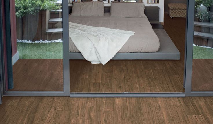 Entity 'Walnut Red' wood-effect Porcelain floor and wall tiles. Natural finish. For indoor or outdoor application. Available in 16x100cm planks. #innovative #interiordesign #woodeffect #walnut #porcelain #tiles
