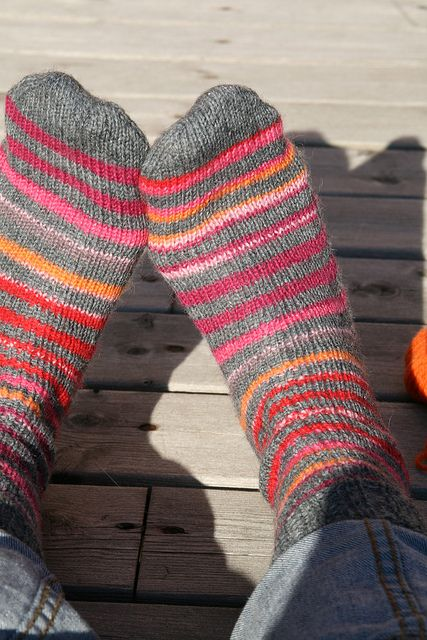 Use your favorite basic sock pattern, left over yarns and pull it all together with a nice grey yarn...