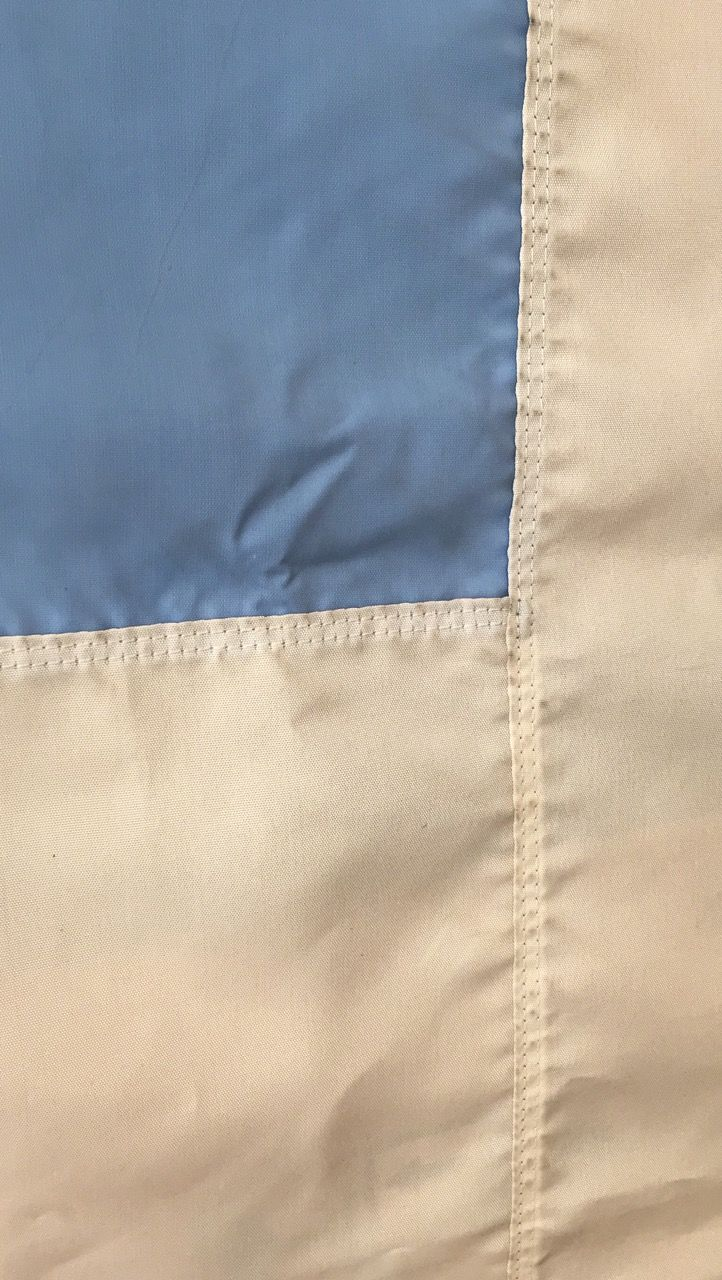 Very old Greek flag in detail beautiful colors Blue of the sea And White