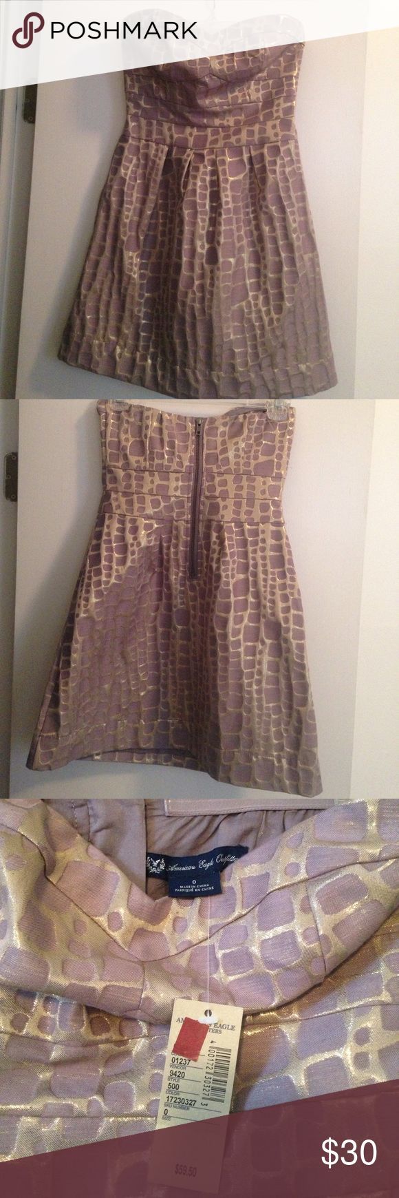 """Cute little cocktail or night out dress Purple and gold mini dress, size 0 from American Eagle, never worn. I'm 5'6"""" and it was just a little too short for my comfort but so pretty!! American Eagle Outfitters Dresses Mini"""