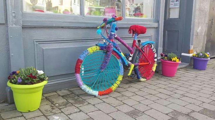 Yarn bombing a bike at INSPIRED Craft Shop, Birr