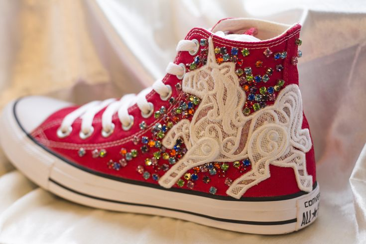 Bon Bon Silver Socks, Unicorn, glitter Rainbow red  Custom Converse , Bespoke shoes/trainers (Van/Converse).  The 'Bon Bon Silver Socks' pair (customisable design) £195  Chuck Taylor All Star Classic High top converse in Red   White Lace unicorn patch.  Rainbow gems.  These are so fun, glittery and always the center of attention.