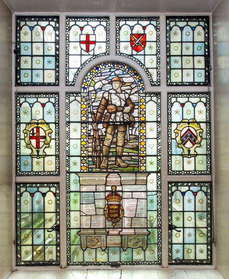 This WWI stained glass memorial is located within the reception area of 31 Jewry Street, London (the original location of the Sir John Cass Technical Institute; now the Sir John Cass Foundation). Highly unusual in this form, especially as it depicts a representative soldier wearing his sheepskin over the top of his uniform for warmth. The names of staff and students of the Institute, killed in action during WWI, are commemorated.