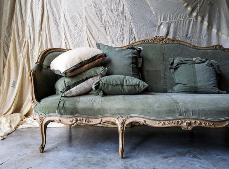Reupholstered by Hudson Louie in army surplus pup tent