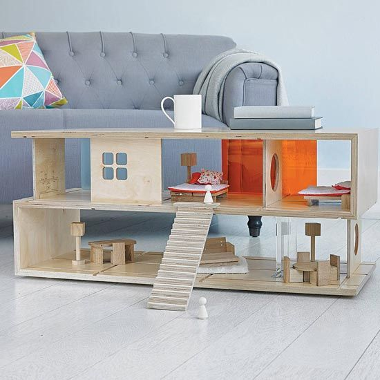 """A doll house that also doubles as a coffee table. Both, little ones and grown ups can enjoy the beautiful design of the """"Qubis Haus"""""""