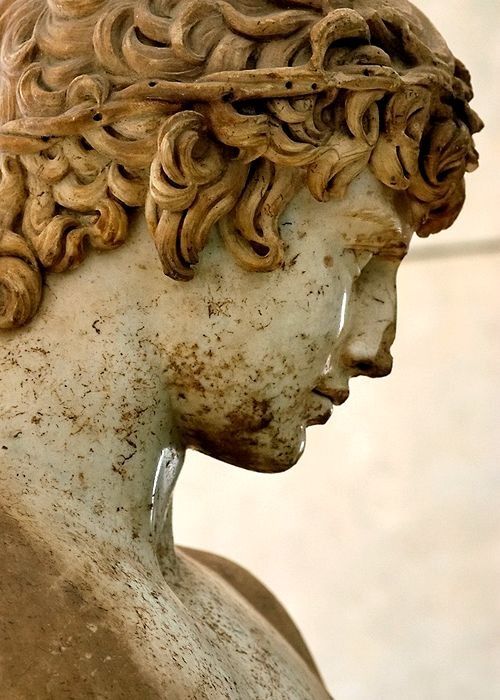 The Delphi Antinous, a cult statue of Antinous, sculpted in Parian marble during the reign of Hadrian (117-138 CE).