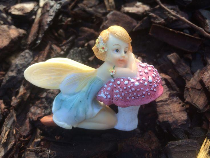 Flower fairy resting on mushroom