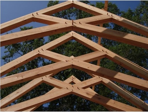 Love the Timberframes!  Credit for this design goes to Clay Chapman.  Very classic scissor trusses.