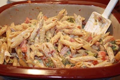 Creamy One Pot Pasta - Pampered Chef Deep Covered Baker (Sun dried tomatoes, chicken, garlic, broccoli, peppers?, cream cheese, etc)
