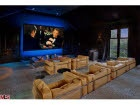 home movie theater room   movie viewing room with creamy beige leather modern seating and blue lighting behind movie