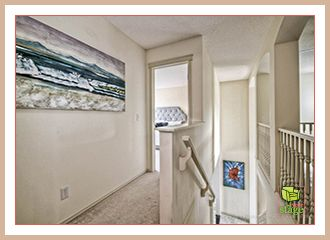 Here is a home staging tip: Use art in hall ways to display the length and possibilities that hall way has to add to the value of the home. It also adds colour to the space!