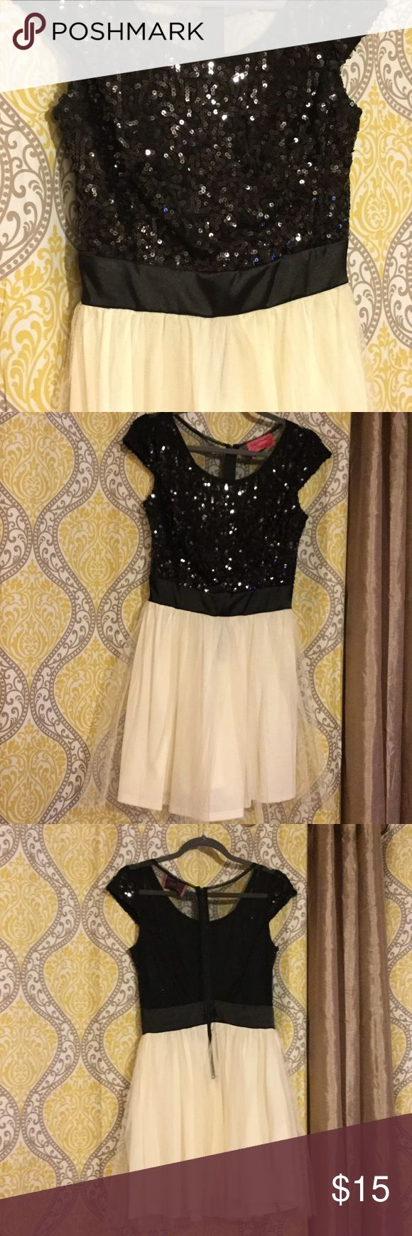 Black and white sequined dress Top is black with sequins on front. The back is black see through mesh. Bottom is two layers. Bottom layer is cotton and layer over that is white meshy. pompous girly Dresses Mini