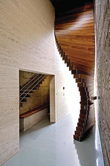 Curtain Door by Matharoo Associates, Surat, India. The door, in fact, forms the main entrance to a showpiece 1,700m² house, designed for Surat-based diamond merchant, Dilip Sanghvi. Featuring a number of equally quirky inventions, including a light-emitting onyx wall that would probably be more at home in a nightclub, this more muted component is described by the architect as the 'curtain raiser', presumably as an introduction to the exuberant architectural performance that lies beyond.