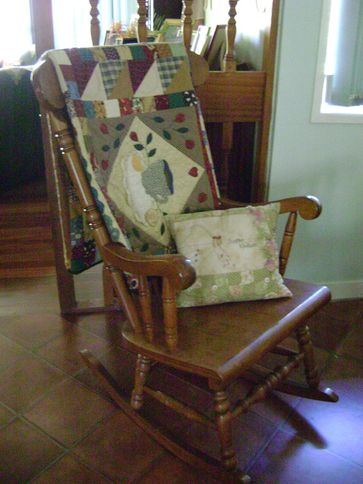 A cosy quilt on a rocking chair