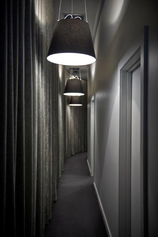 Luxurious lighting and furnishings lead the way to the treatment rooms at A Touch of Beauty. Interior design by Enoki