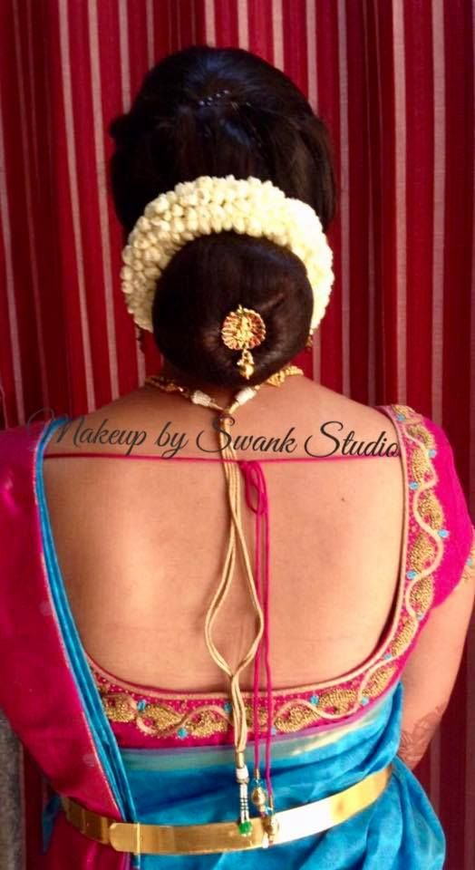 Indian bride's hairstyle by Swank Studio. Bridal updo. Hair bun. Saree Blouse Design. Hair Accessories. Tamil bride. Telugu bride. Kannada bride. Hindu bride. Malayalee bride. Find us at https://www.facebook.com/SwankStudioBangalore